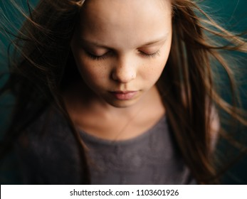 a girl with closed eyes