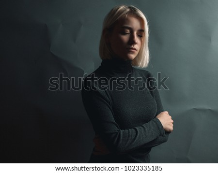Girl with closed eyes in studio
