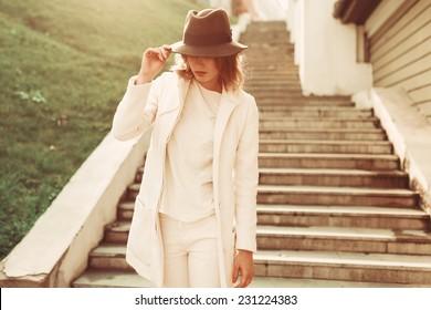 Girl in coat in the sun Posing