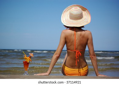 girl with cocktail on the sea