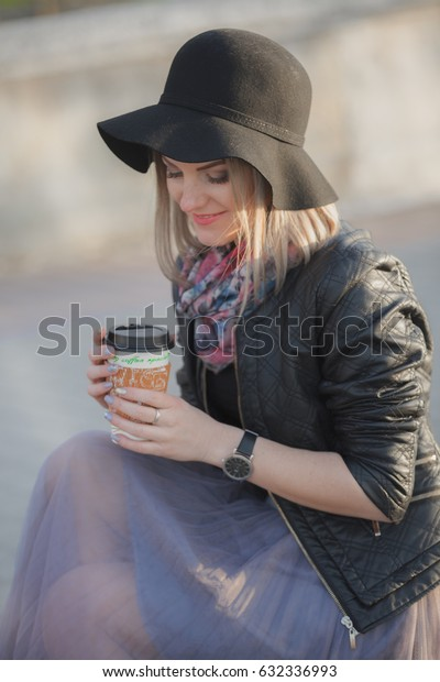 Girl with coffee at a street