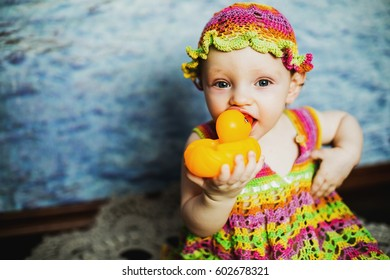 girl in colored Panama with a toy duck