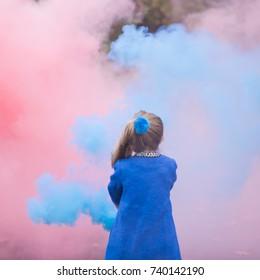 girl and colored smoke