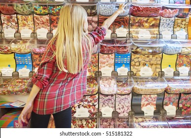 Girl and colorful candies in the background