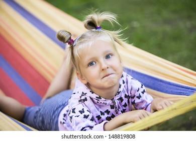 girl in colorful hammock
