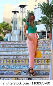 Girl in the colorful steps of the village