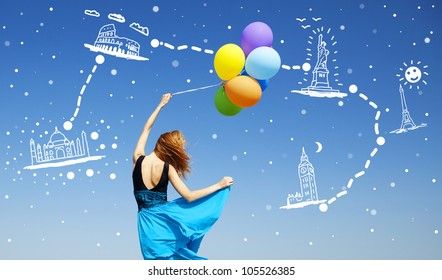 Girl with colour balloons at blue sky background dreaming abut new traveling.