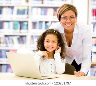 Girl with a computers teacher looking very happy