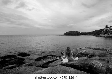 Girl contemplating the sea from the cliffs at Manly beach, Manly, Australia, October 2017