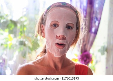 Girl with a cosmetic mask on her face