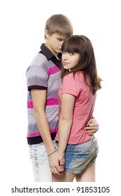 The girl costs with the guy on a white background