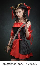 Girl in costume pirate with a sword