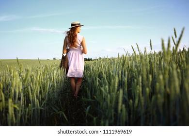 Girl in countryside, in green field wheat, outdoor
