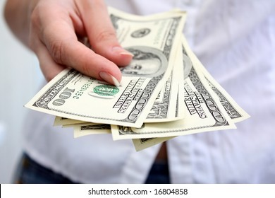 Girl  counts dollars