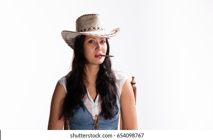 Girl cowboy with a cigarette
