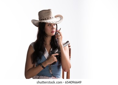Girl cowboy with a cigarette, woman with a gun