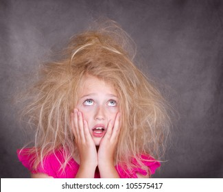 Girl with crazy bed head or tangled hair