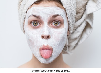 Girl with cream on her face and a towel on his head