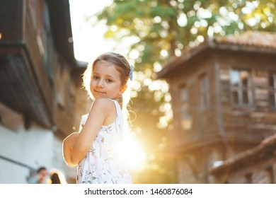 girl with crossed hands in sunset light