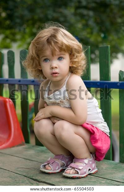 Girl Crouching On Image & Photo (Free Trial)   Bigstock