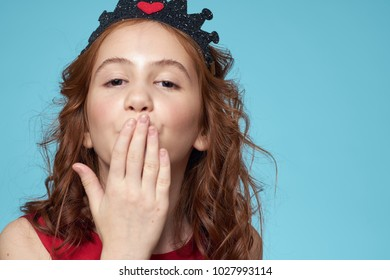 girl in the crown on a blue background, portrait, beauty, studio