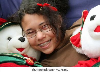 Girl cuddling Christmas bears