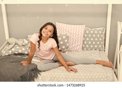 Girl cute baby with long curly hair wear pajamas. Hair every girl dream. Evening routine with long unruly hair. Child with gorgeous hairstyle smiling. Childrens tips and techniques for healthy hair.