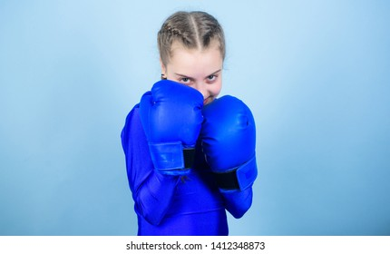 Girl cute boxer on blue background. With great power comes great responsibility. Boxer child in boxing gloves. Rise of women boxers. Female boxer change attitudes within sport. Free and confident.