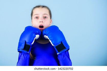 Girl cute boxer on blue background. With great power comes great responsibility. Boxer child in boxing gloves. Female boxer change attitudes within sport. Risk of injury. Rise of women boxers.