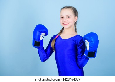 Girl cute boxer on blue background. Rise of women boxers. Female boxer change attitudes within sport. Feminism concept. With great power comes great responsibility. Boxer child in boxing gloves.