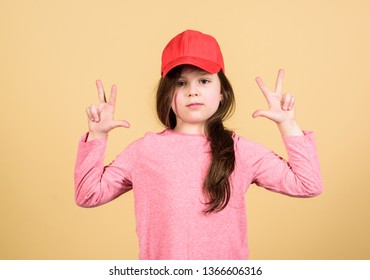 Girl cute child wear cap or snapback hat beige background. Little girl wearing bright baseball cap. Modern fashion. Kids fashion. Stylish accessory. Feeling confident with this cap. Cutie in cap.