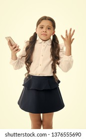 Girl cute long curly hair holds smartphone white background. Child desperate helpless face expression holds smartphone. Chatting friends online communication. Bad connection. Cell connection problem.
