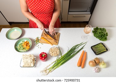 Girl cutting carrots and preparing food