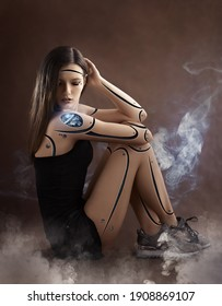 Girl cyborg robot sits on a brown background. white smoke around