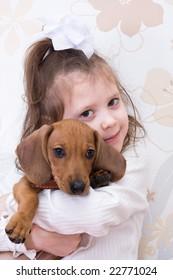 girl and dachshund puppy