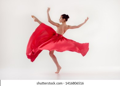 girl dancer. In a beautiful red dress in motion