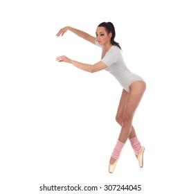 Girl dancer dressed as a ballerina with beautiful makeup studio