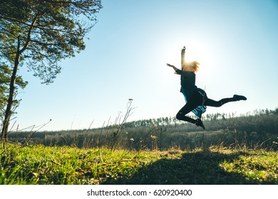 The girl dances in the nature, is engaged in yoga, fight with the dragons, earlier morning, an active way of life happy, scarf