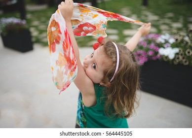 girl dancing with colorful scarf