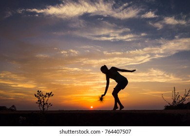 girl dancing on the beach, silhouette