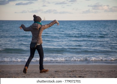 Girl dancing on the beach at sunset - winter season - story telling sequence.