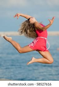 Girl is dancing outdoors