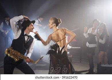 Girl dancing with saxophonist