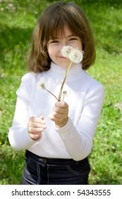 Girl and dandelions