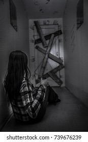 The girl in the dark corridor before the last boarded-up door. Creepy house with ghosts.