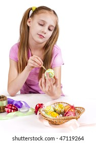 girl decorates Easter eggs