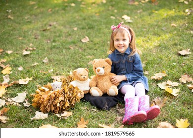 a girl in a denim dress sits and smiles on a strava with bears - Shutterstock ID 1819579565