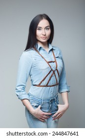 girl in a denim shirt with straps