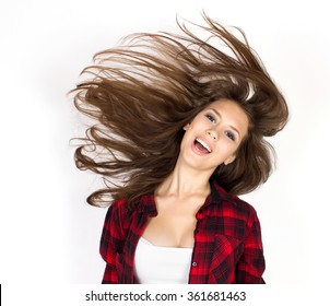 the girl with the developing hair it is photographed in studio on a white background