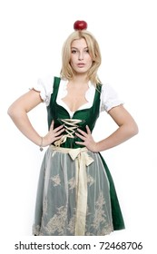 Girl in a dirndl with an apple on his head